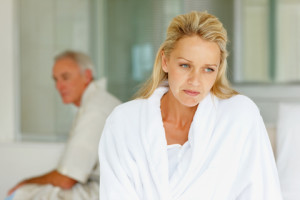 purch worried woman and hubby in bed 300x200